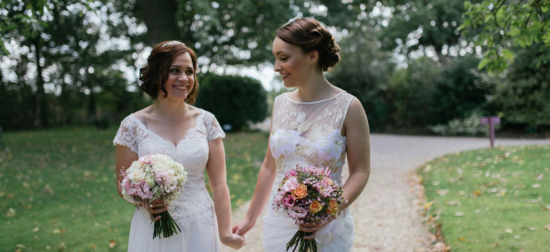 hand-in-hand-brides-at-dodmoor-house-lesbian-wedding-venue-northamptonshire-barn-gay-wedding-venue-northamptonshire-the-gay-wedding-guide