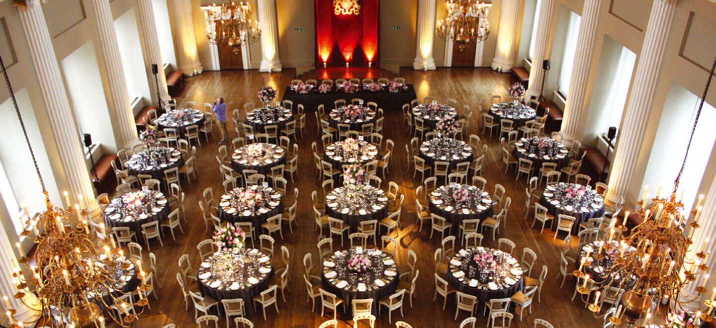 Banqueting-House-reception-layout-circular-tables-a-Royal-Palace-Wedding-Venue-in-London-via-the-Gay-Wedding-Guide