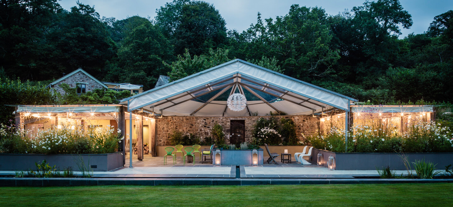 Covered-Terrace-with-chandelier-Ever-After-country-wedding-venue-Devon-PL19-a-Tavistock-wedding-venue-via-the-Gay-Wedding-Guide