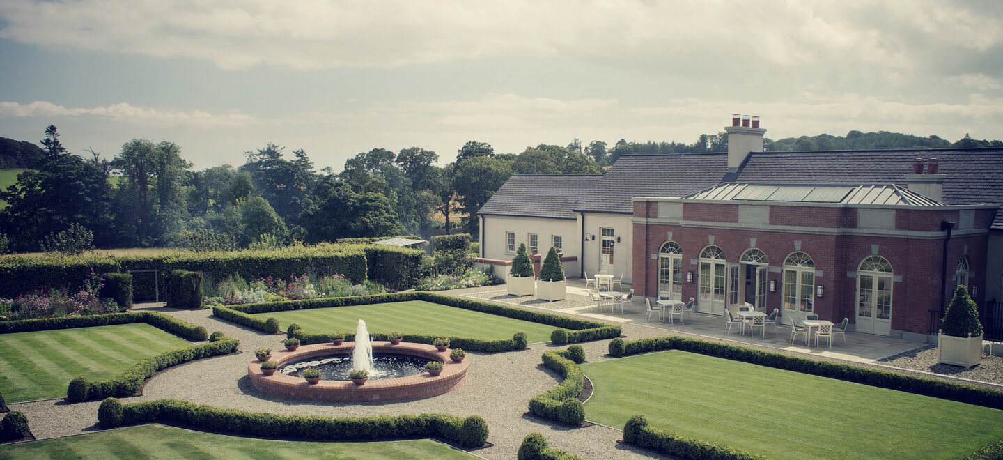 Facade-and-lawns-at-wedding-venue-ballynahinch-the-Carriage-Rooms-a-barn-wedding-co-down