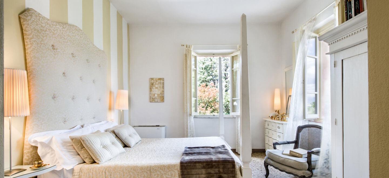 Fontelunga-gay-hotel-Italy-Florence-gay-Italy-travel-gay-honeymoon-gay-wedding-guide-italy-honeymoon-self-catering-italy-avorio-bedroom-1