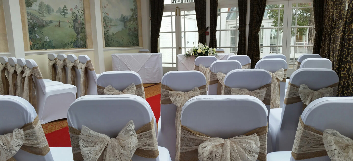 Lace-Chair-cover-ties-at-The-Quorn-Country-Hotel-Leicestershire-wedding-venue-quorn-via-the-Gay-Wedding-Guide