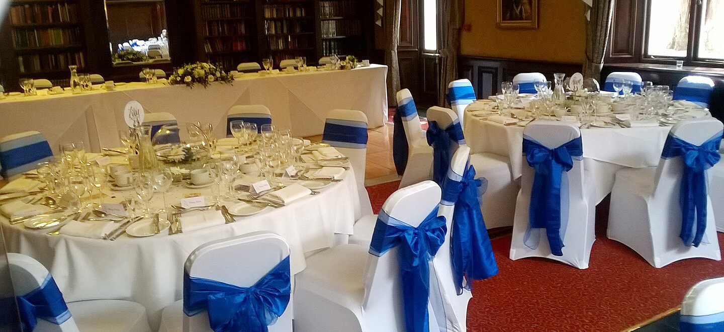 Library-with-blue-chair-sashes-at-The-Quorn-Country-Hotel-Leicestershire-wedding-venue-quorn-via-the-Gay-Wedding-Guide