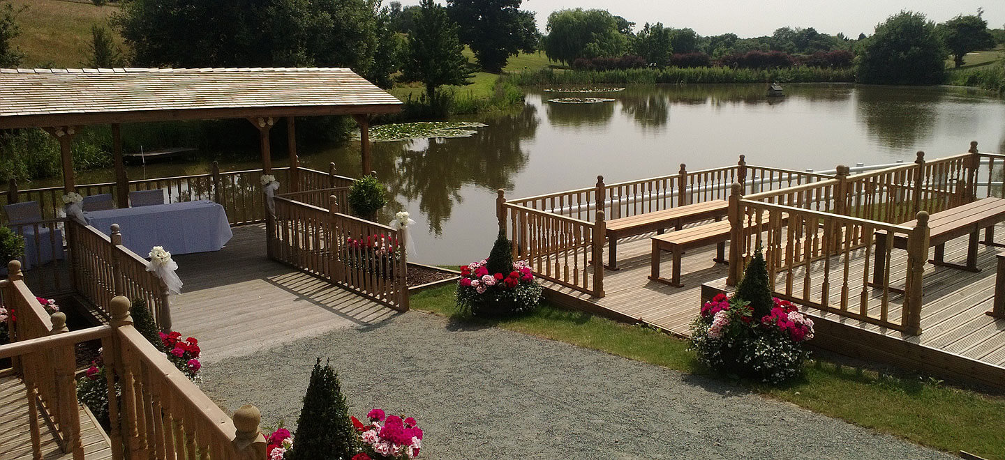 Wedding-ceremony-by-the-lake-at-Warley-Park-Brentford-Wedding-Venue-Esssex-via-The-Gay-Wedding-Guide