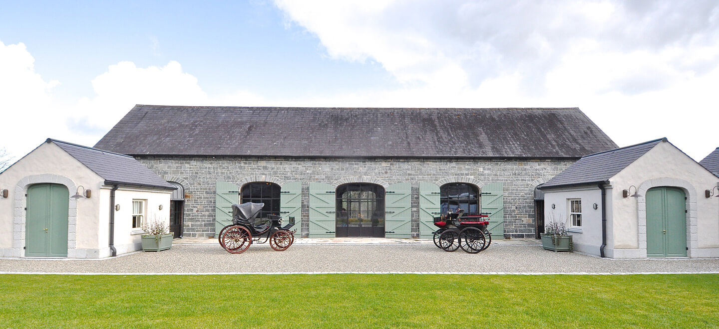 courtyyard-with-carriages-setting-at-wedding-venue-ballynahinch-the-Carriage-Rooms-a-barn-wedding-co-down