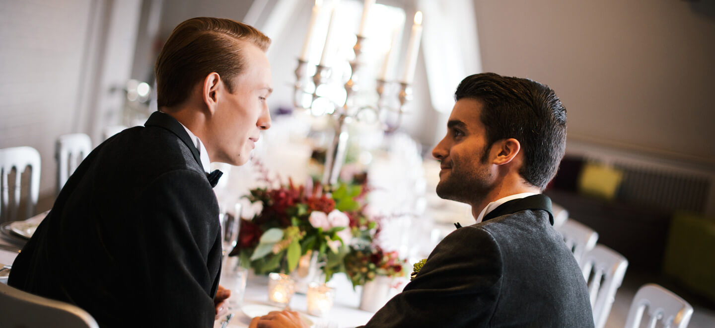 grooms-holding-hands-at-Shakespeares-Globe-London-wedding-venue-theatre-wedding-SE1-civil-partnership-gay-wedding-celebration