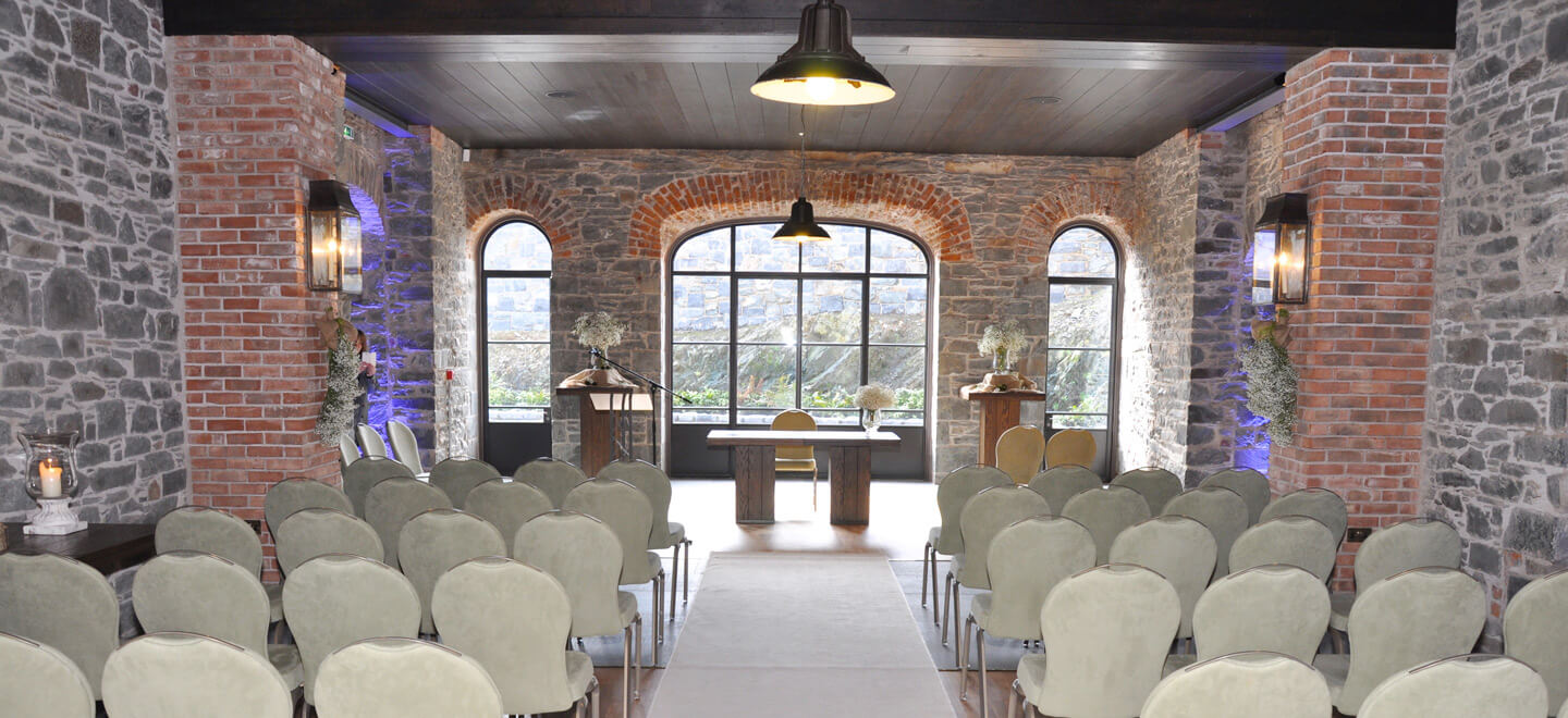indoor-barn-wedding-ceremony-setting-at-wedding-venue-ballynahinch-the-Carriage-Rooms-a-barn-wedding-co-down