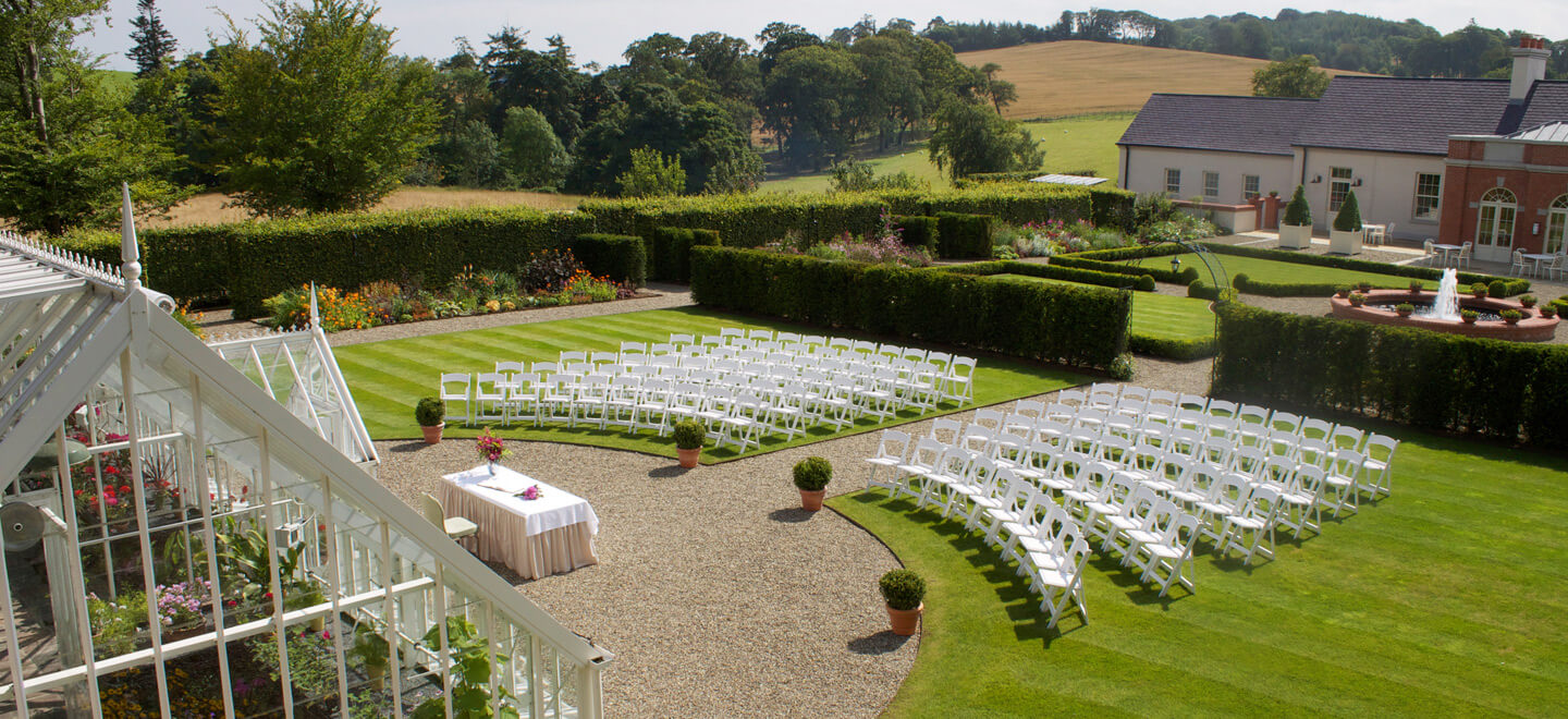 outdoor-ceremony-setting-at-wedding-venue-ballynahinch-the-Carriage-Rooms-a-barn-wedding-co-down
