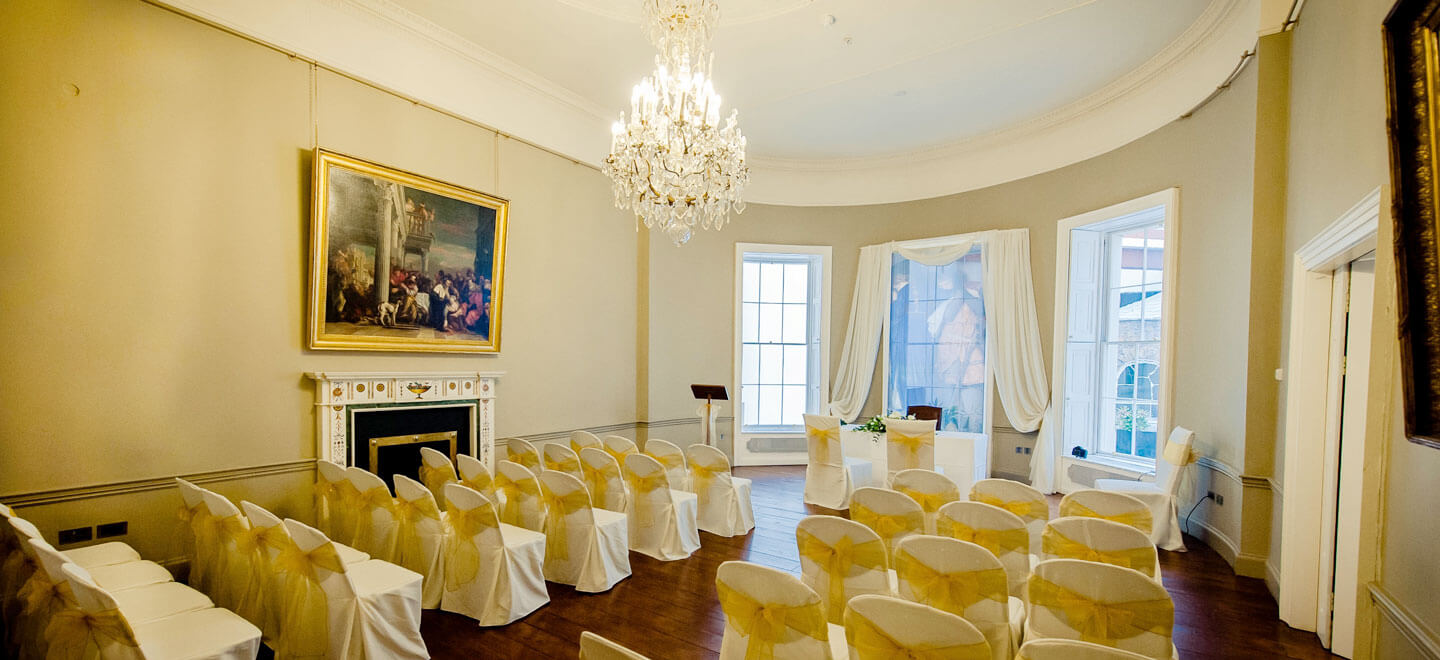 Civil-ceremony-layout-at-unique-wedding-venue-art-gallery-the-national-gallery-of-ireland-via-the-Gay-Wedding-Guide