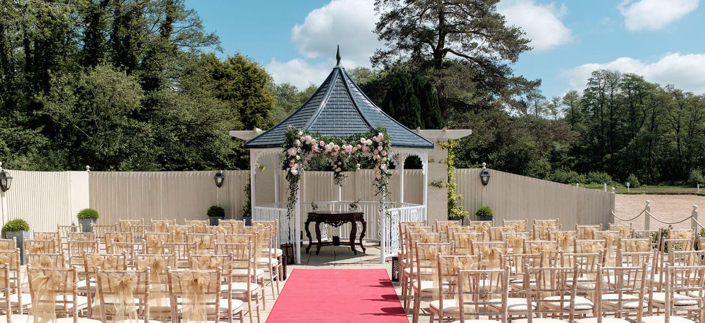 Outdoor-wedding-ceremony-at-Southdowns-Manor-Luxury-Gay-Wedding-Venue-in-Petersfield