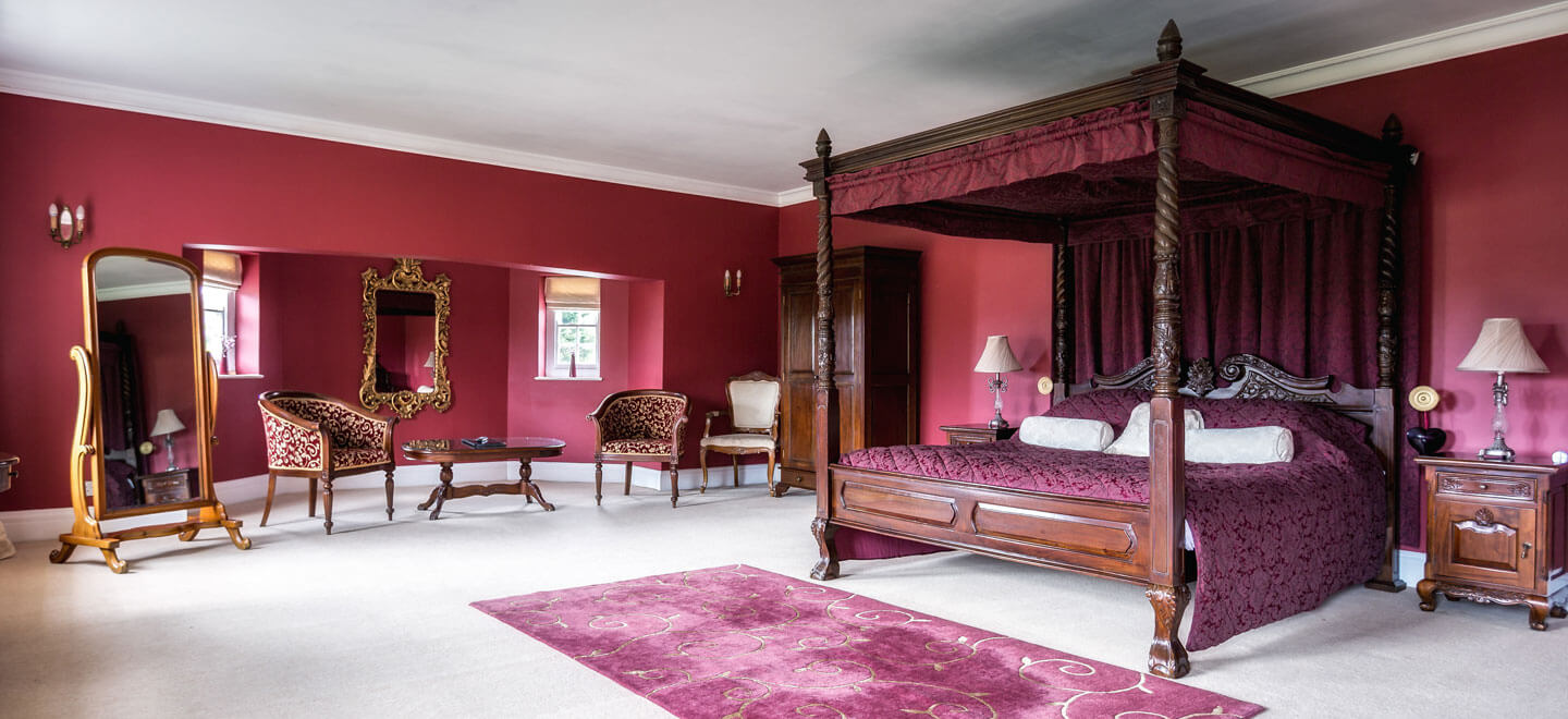 Red-bedroom-at-Parklands-gay-wedding-essex-venue-the-gay-wedding-guide-house