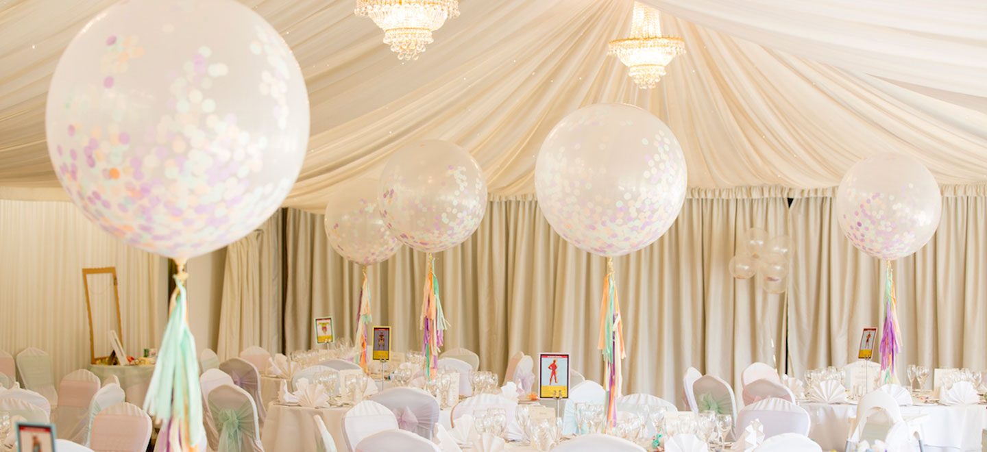cream-wedding-theme-with-big-confetti-balloons-at-Fennes-Gay-Wedding-Venue-in-Essex