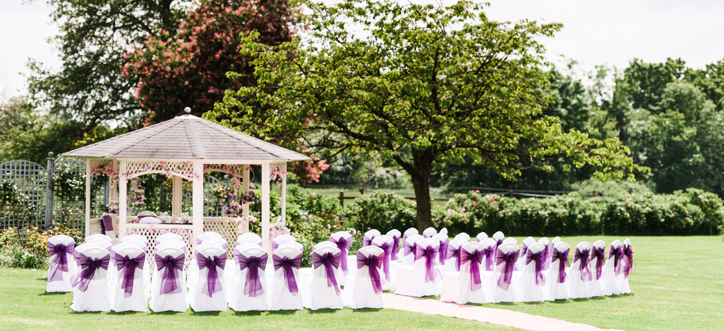outdoor-wedding-Essex-in-pagoda-at-Fennes-Gay-Wedding-Venue-in-Essex-House