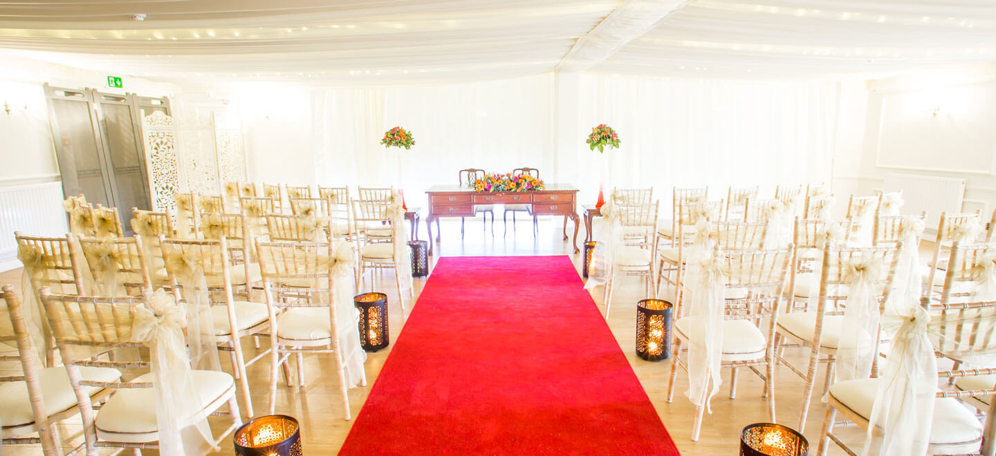 red-carpet-aisle-at-Southdowns-Manor-Luxury-Gay-Wedding-Venue-in-Hampshire