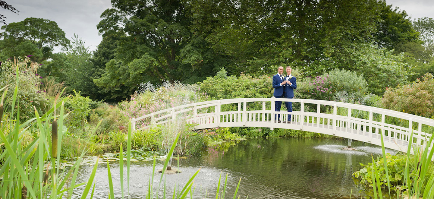 same-sex-wedding-on-bridge-at-Fennes-Gay-Wedding-Venue-in-Essex-via-the-Gay-Wedding-Guide