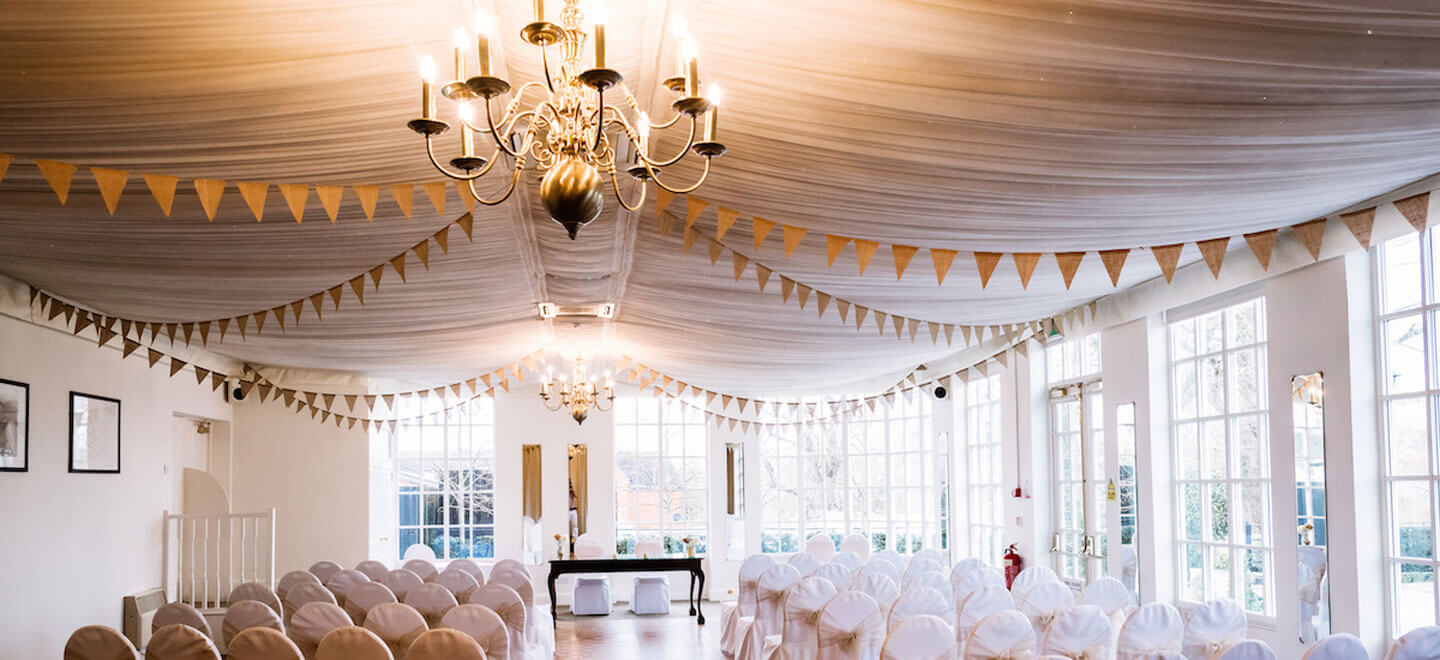 ceremony-room-with-drapes-at-Warwick-House-luxury-gay-weddiung-venue-in-Warwickshire
