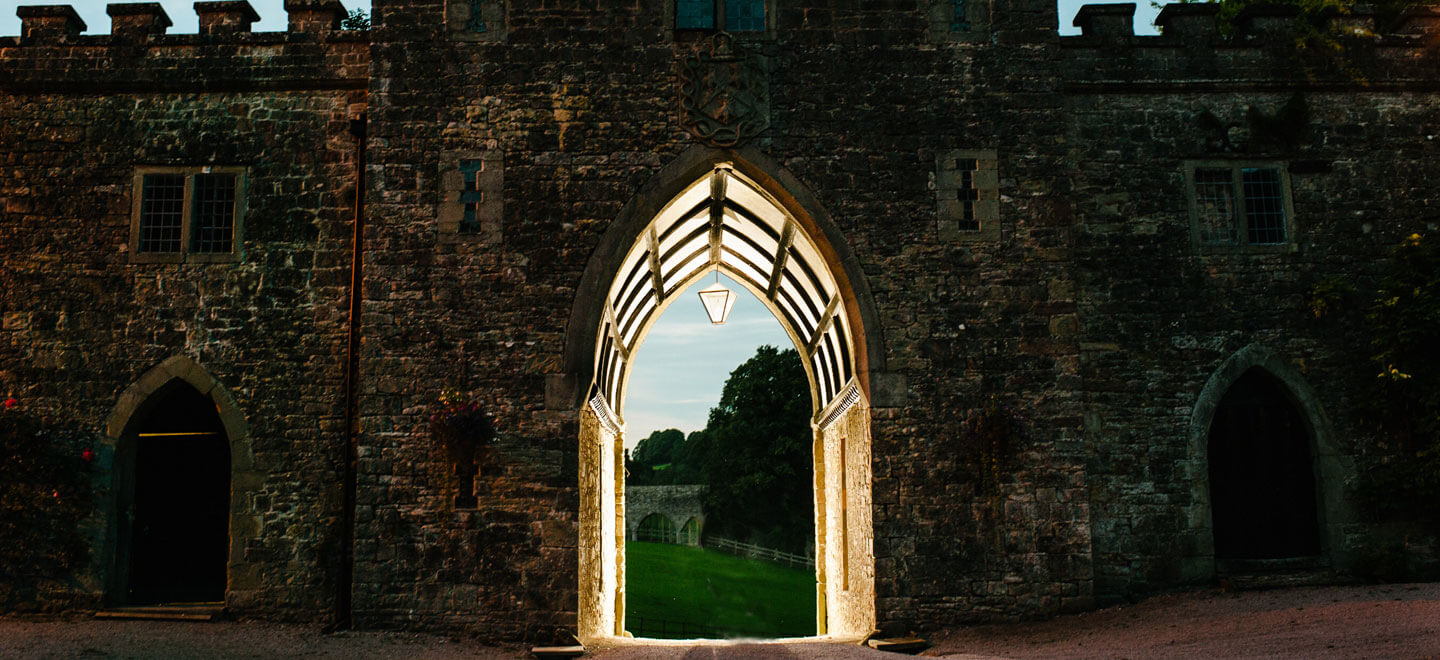 Clearwell-Castle-Portcullis-at-Night-Castle-wedding-Venue-Gloucesershire-via-The-Gay-Wedding-Guide