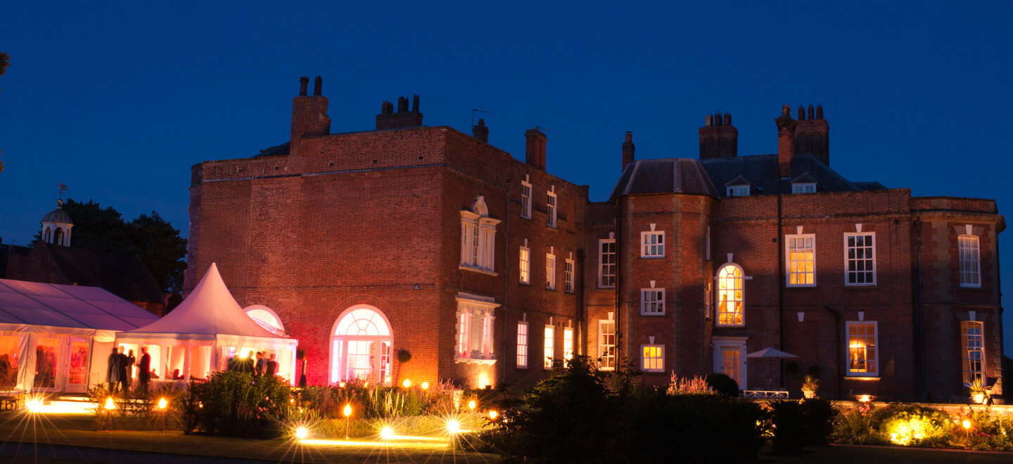 Iscoyd-Park-House-night-with-marquee-Shropshire-gay-wedding-venue-via-the-Gay-Wedding-Guide