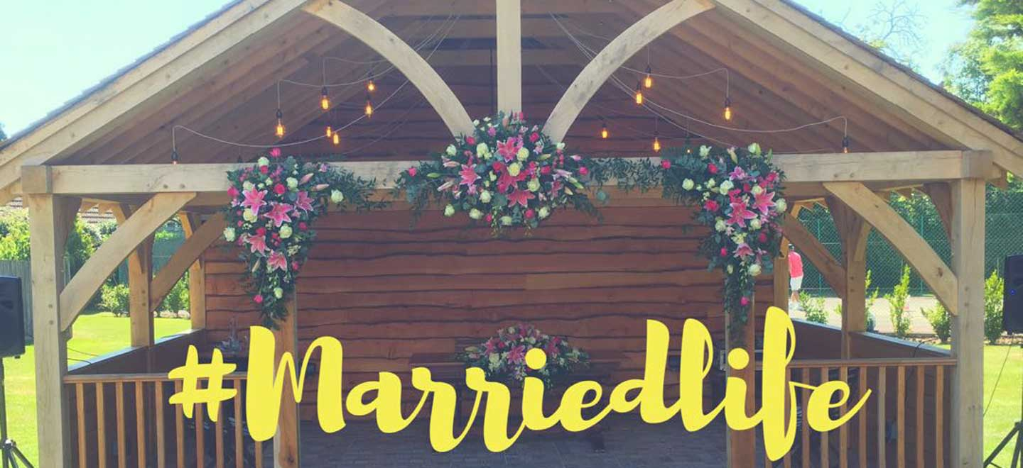 Married-Life-Banner-with-Flowers-at-Balmer-Lawn-Gay-wedding-venue-Brockenhurst-via-the-Gay-Wedding-Guide