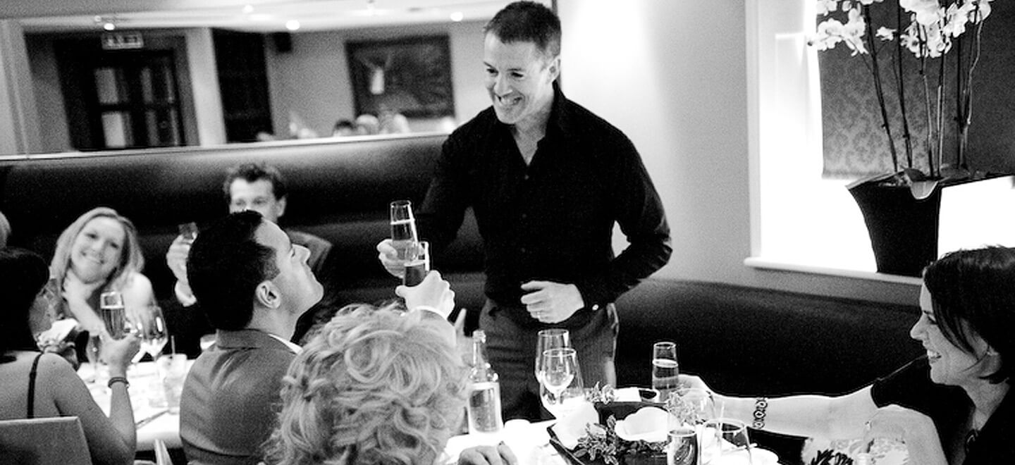 Toasting-the-grooms-at-Drakes-Brighton-boutique-hotel-and-wedding-venue-in-Brighton-on-teh-gay-wedding-guide