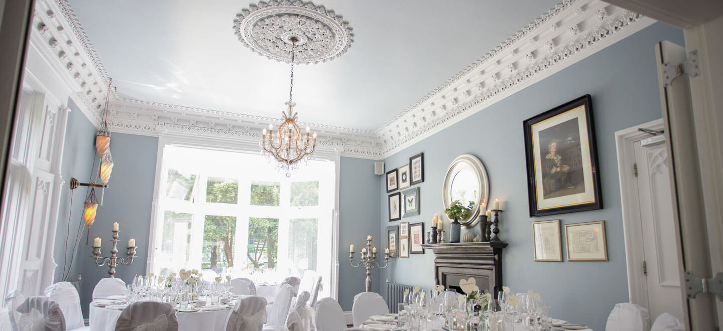 Blue Lounge ceremony layout at gay friendly Manchester Wedding Venue Didsbury House via The Gay Wedding Guide