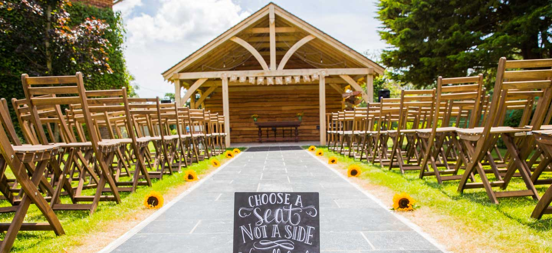 Outdoor gazebo Choose a Seat not a Side Balmer Lawn Gay wedding venue Brockenhurst via the Gay Wedding Guide
