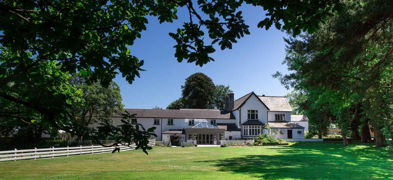 External view of Llechwen Hall Hotel and garden a country house wedding venue Glamorgan gay wedding guide 1