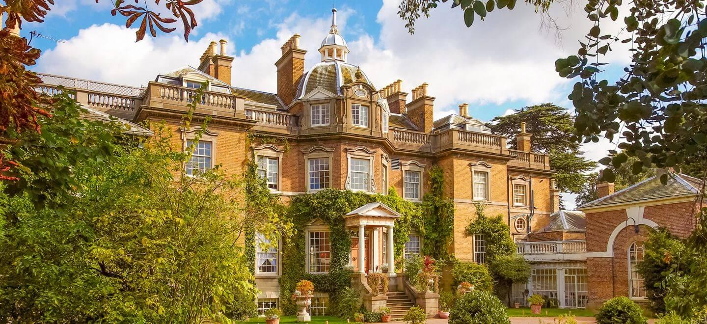 Facade of Hampton Court House country house wedding venue surrey gay wedding guide 1