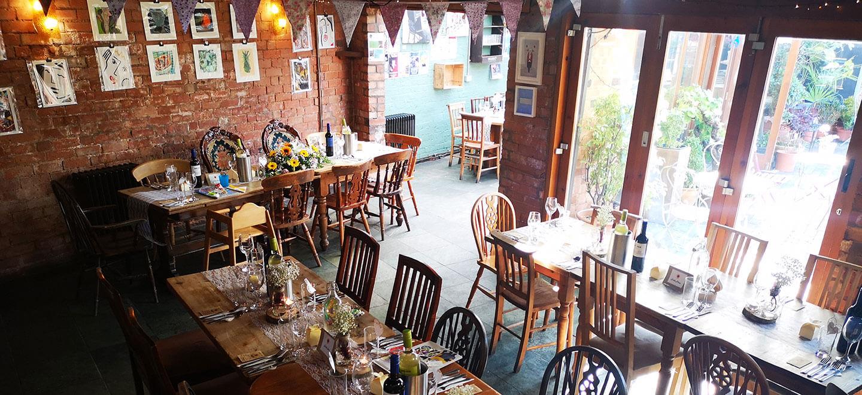 dining space at unique birmingham wedding venue kitchen garden cafe via gay wedding guide 1