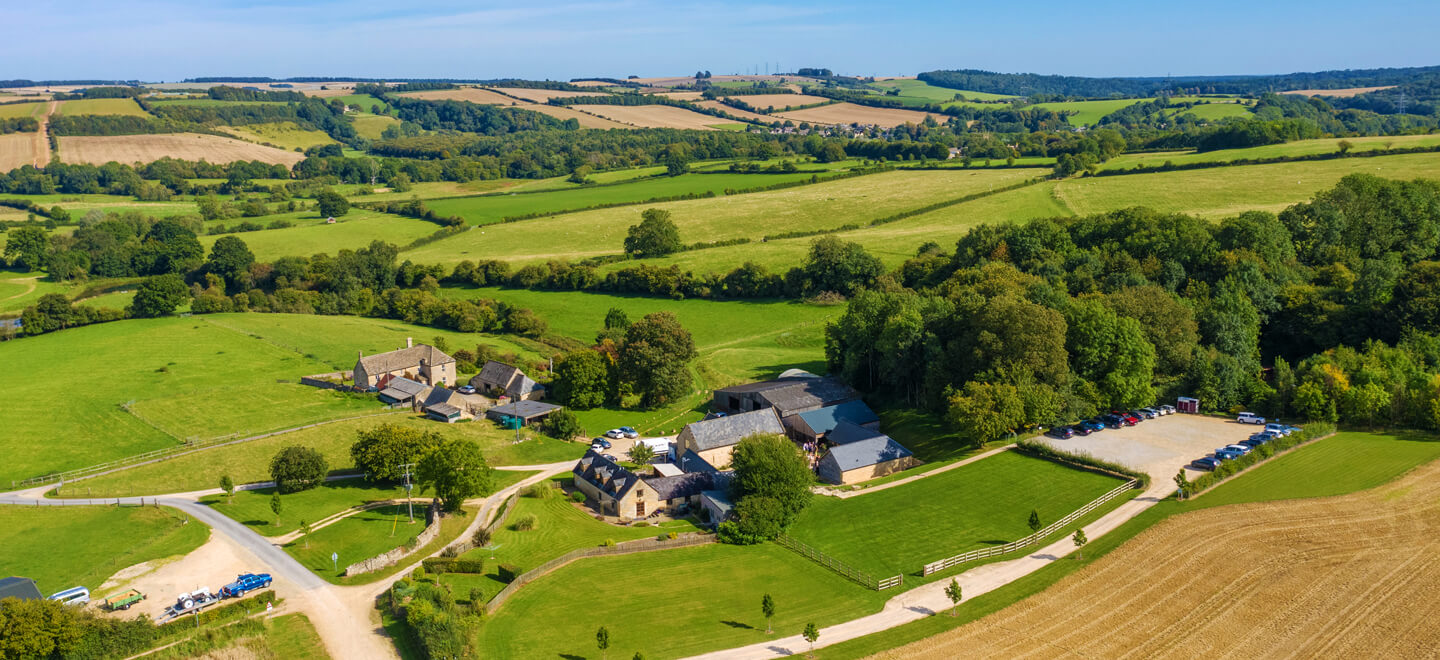 upcote barns arial view in cotswolds via gay wedding guide by rob tarren