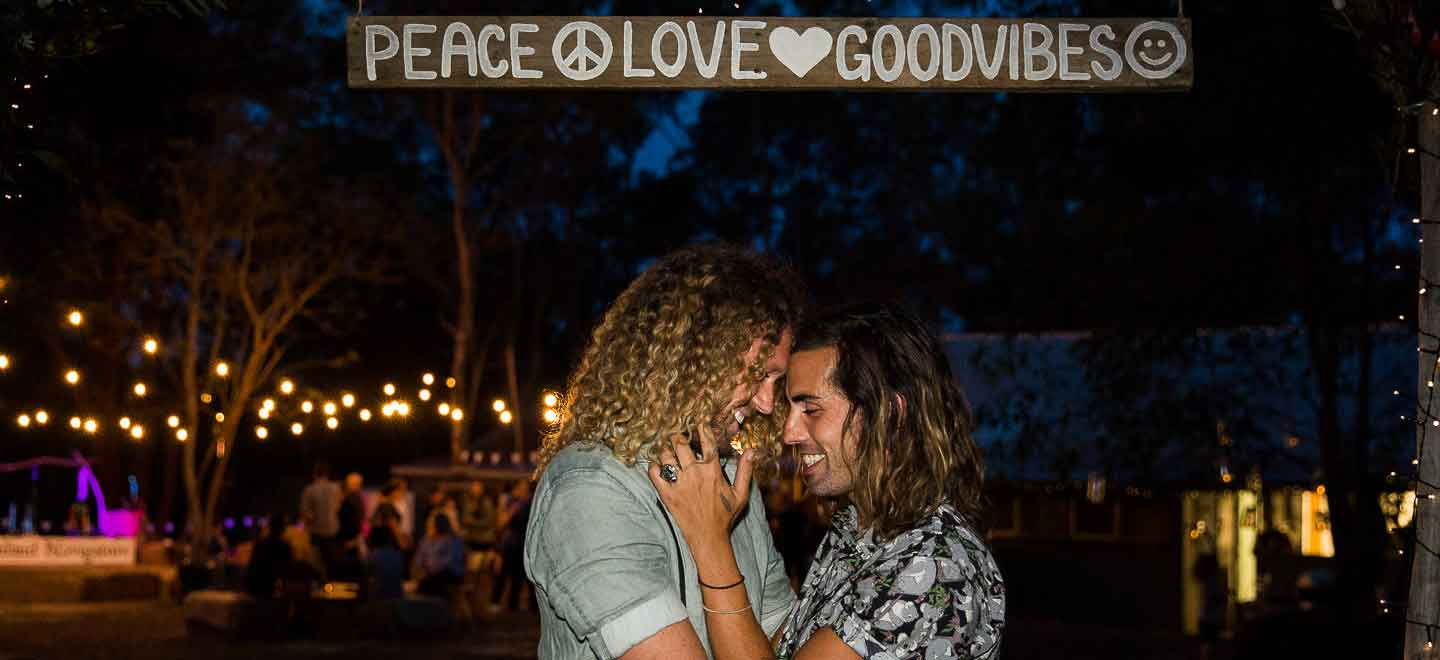 12 Peace love good vibes sign above gay grooms image by Next Chapter Photography London wedding photographer Sydney via Gay Wedding Guide 6
