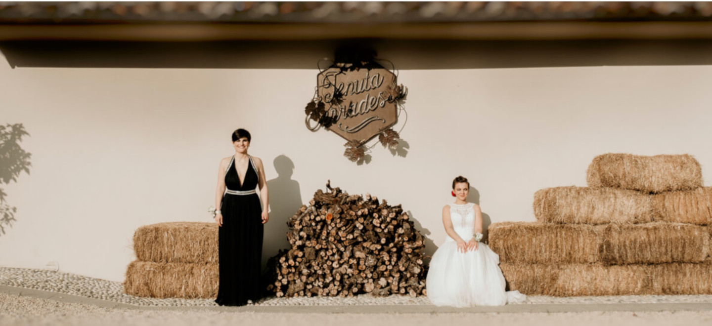 1440 1Agnese and Gaia by hay bales at their lesbian wedding photography Frank Cattuci Photo via Gay Wedding Guide 1