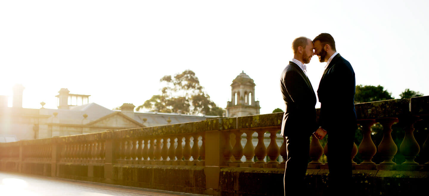 1440 Chris and Ben outside with sun rays at their gay wedding gatsby themed gay wedding guide 3