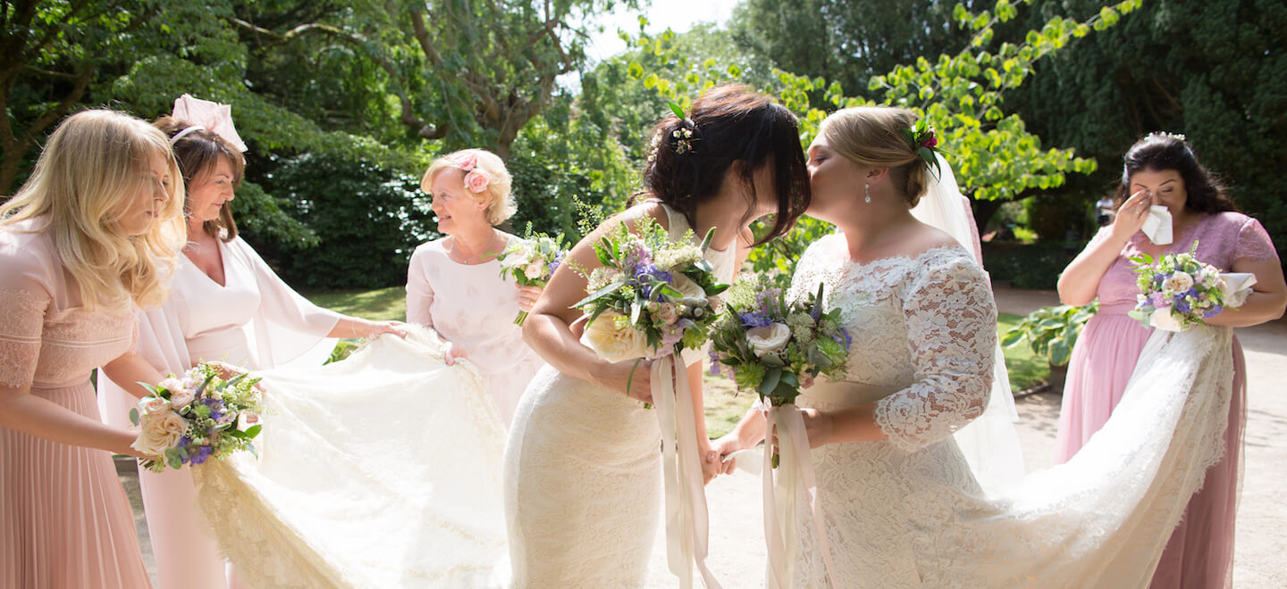 2 wedding party hold out brides trains by ragdoll photography lesbian Staffordshire wedding photographer gay wedding guide 6