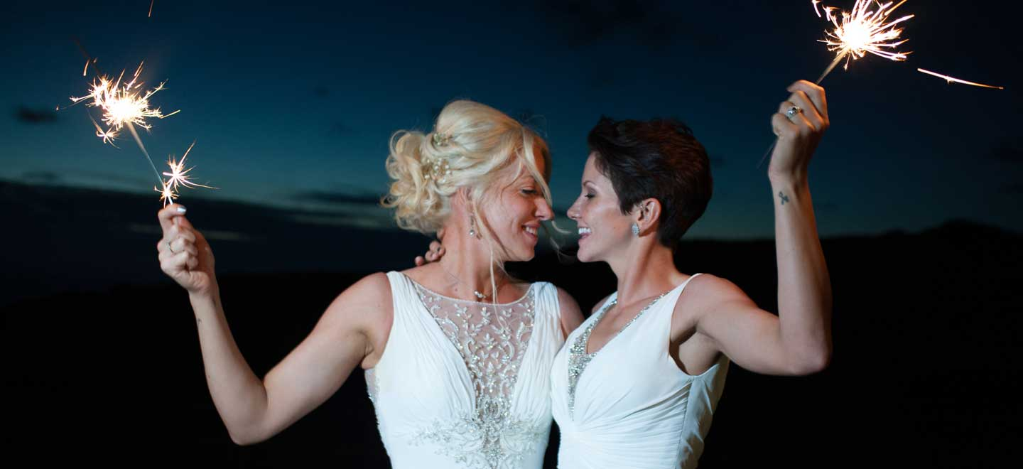 Brides hold sparklers at lesbian wedding of emma and amy at ocean kave image by MrsJutsonPhotography 1 4