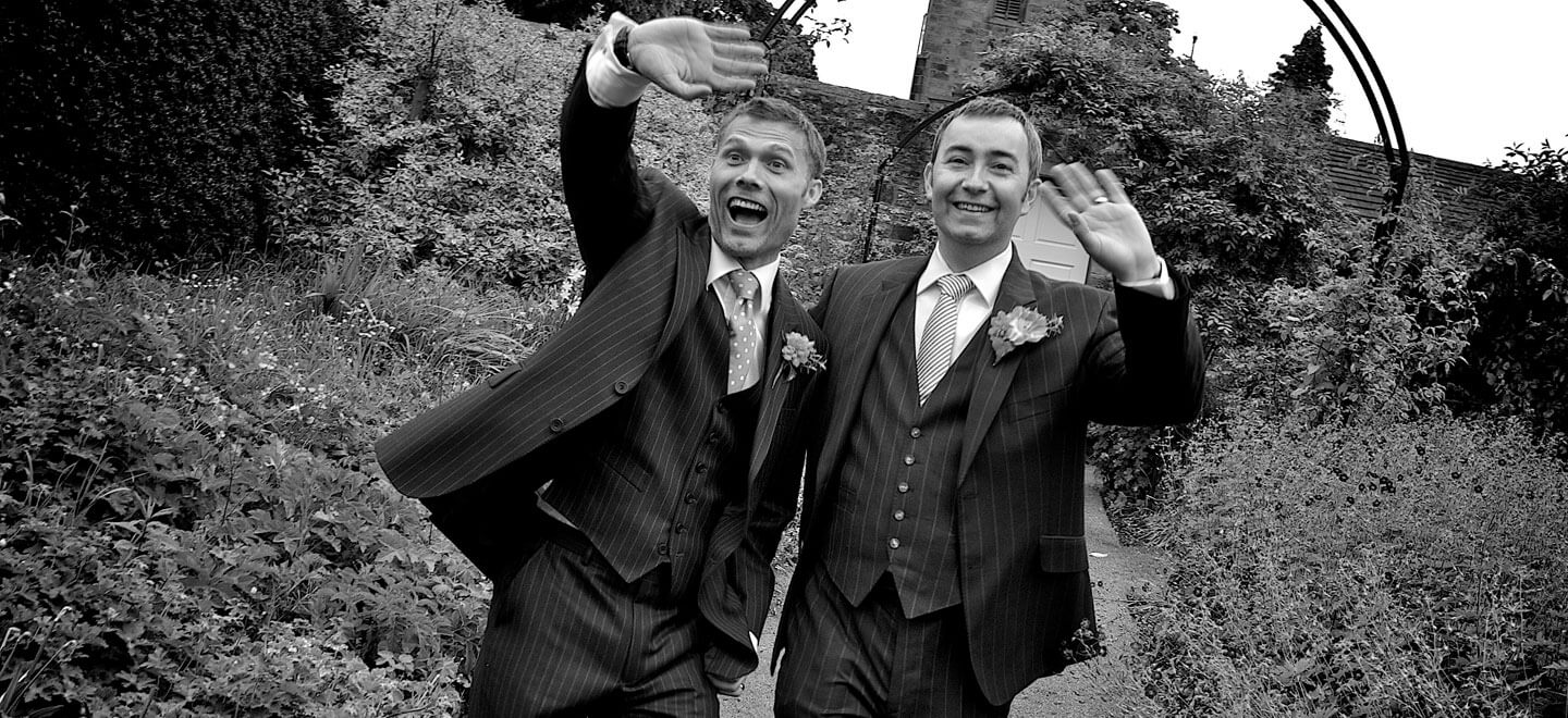 Gay Grooms Walking in Garden Image by Tony Hall Gay Wedding Photographer Derby 6