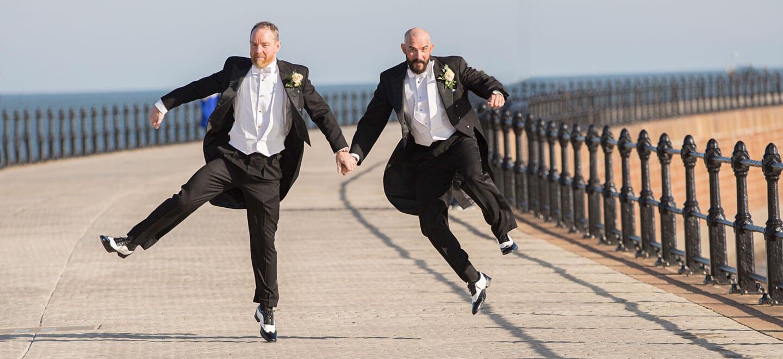 Glen Jason click heels at their gay wedding photographer This World Wedding Photography via Gay Wedding Guide 6