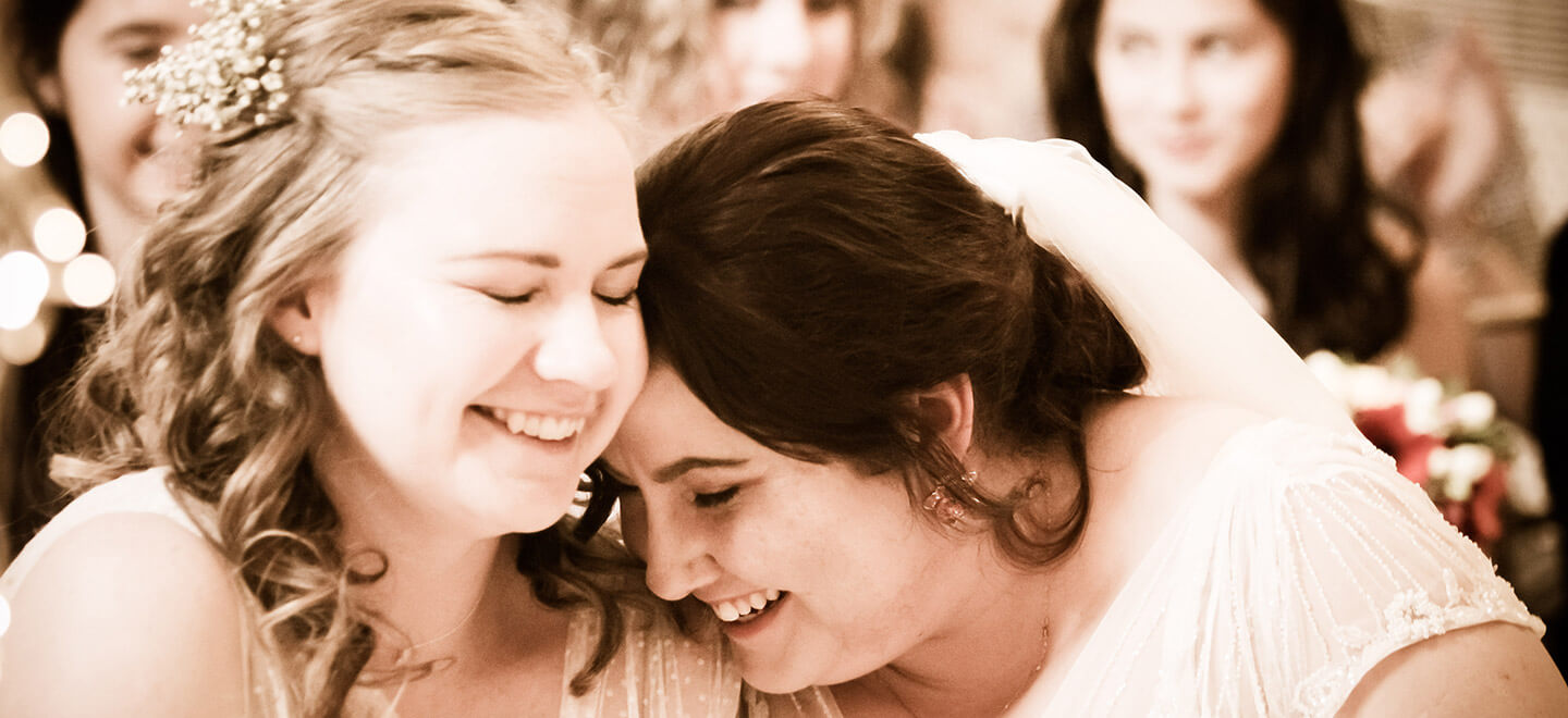 Lesbian brides laughing photograph by Paul Walker Photographer Gay Wedding Guide 6