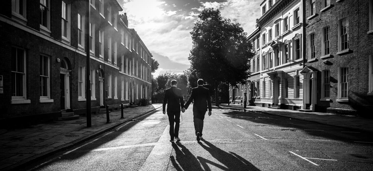 Neil and Ryan walking down the street by James Tracey gay wedding photography via the gay wedding guide 6