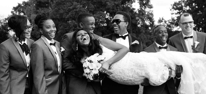 One bride held lengthwayslesbian wedding copyright Hazel Buckley Photography via The Gay Wedding Guide 4