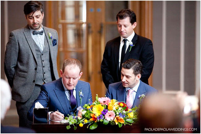 Real gay wedding Matt and Dan signing register gay wedding photographer Paola De Paola copyright Paola de Paola 3