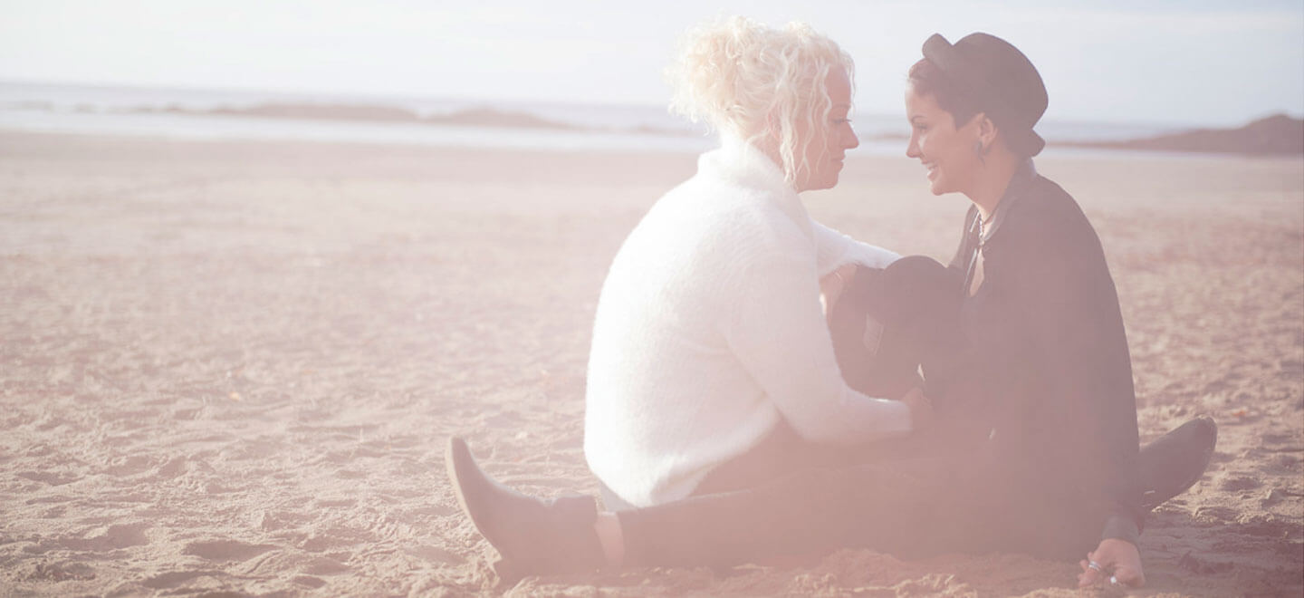 Sun drenched sitting on Beach with Dog Emily and Amy Engagement Photography and copyright Mrs Jutson Photography via The Gay Wedding Guide 3 4