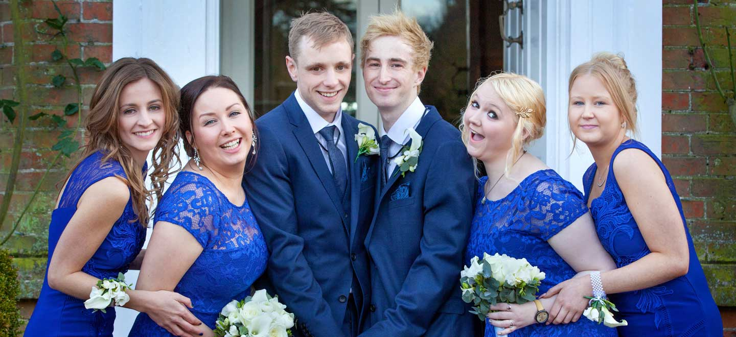 Two grooms with bridesmaids at real gay wedding image copyright Mirror Imaging Photography via the Gay Wedding Guide 3