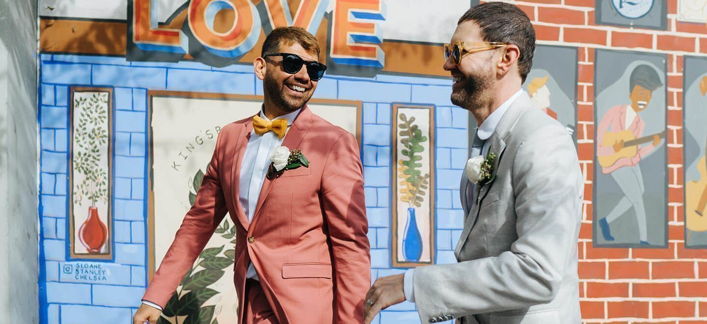 gay grooms holding hands and laught josephine elvis 1440x660 1 6