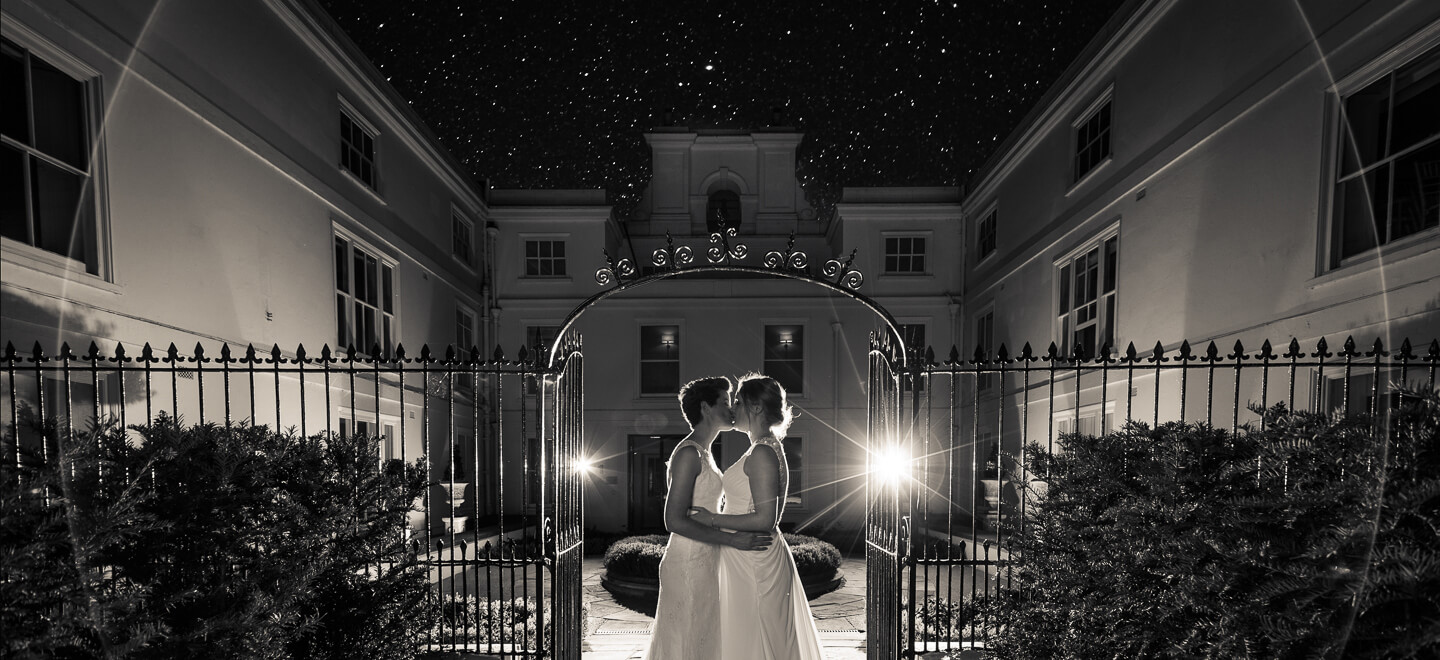 lesbian brides kiss beneath the stars image by lesbian wedding photography Pike Photography via gay wedding guide 6