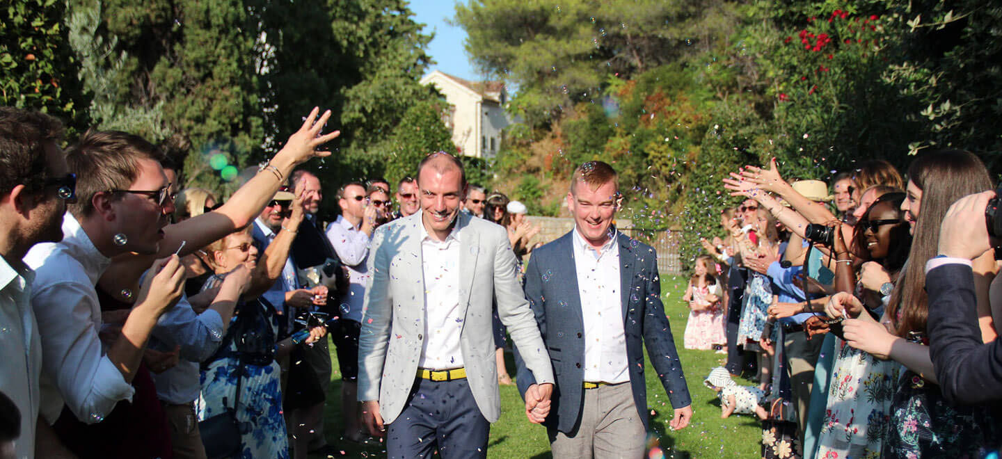 throwing confetti at Nick and Toms real gay wedding croatia via The Gay Wedding Guide 1 4